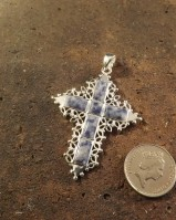 silver cross with sodalite stones