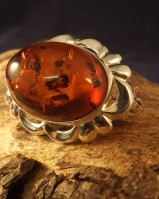 SILVER BROOCH SET WITH AMBER