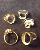 ASSORTED SILVER RINGS 5